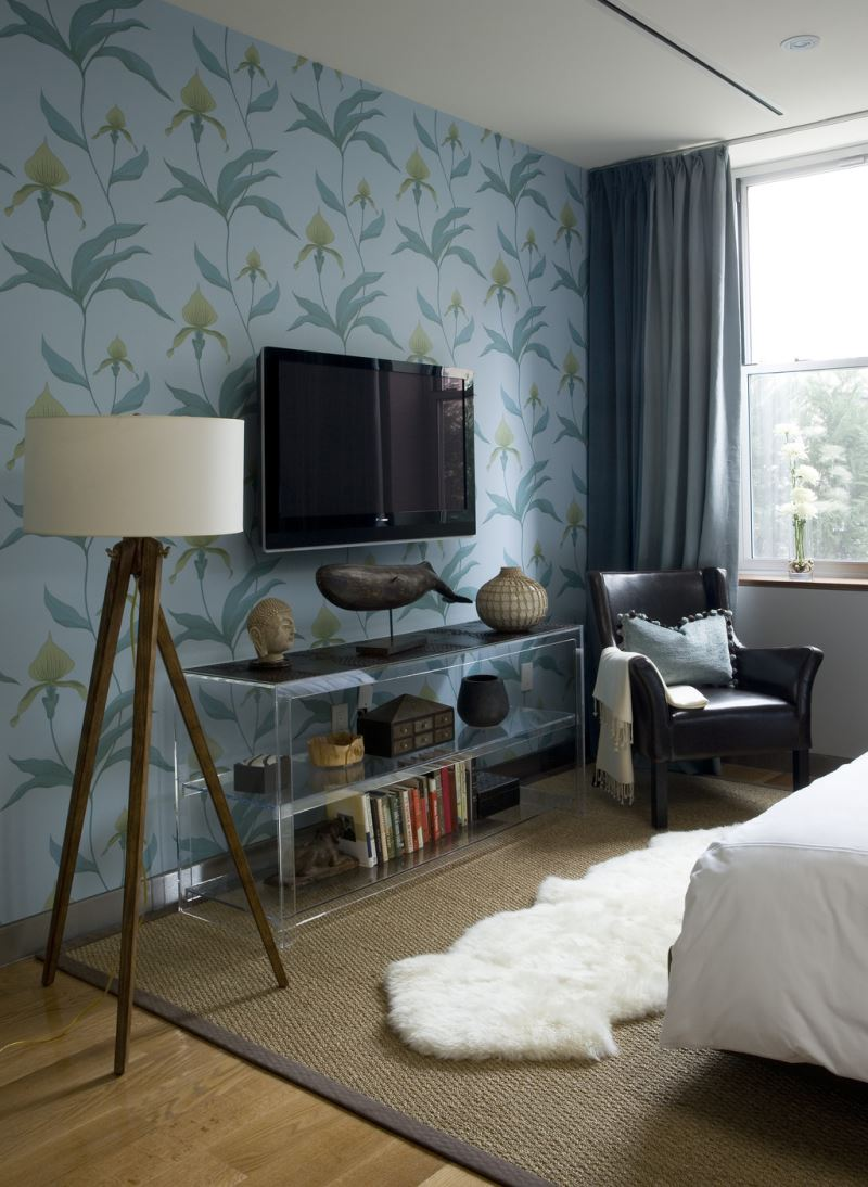 Wallpapered accent wall in a modern bedroom