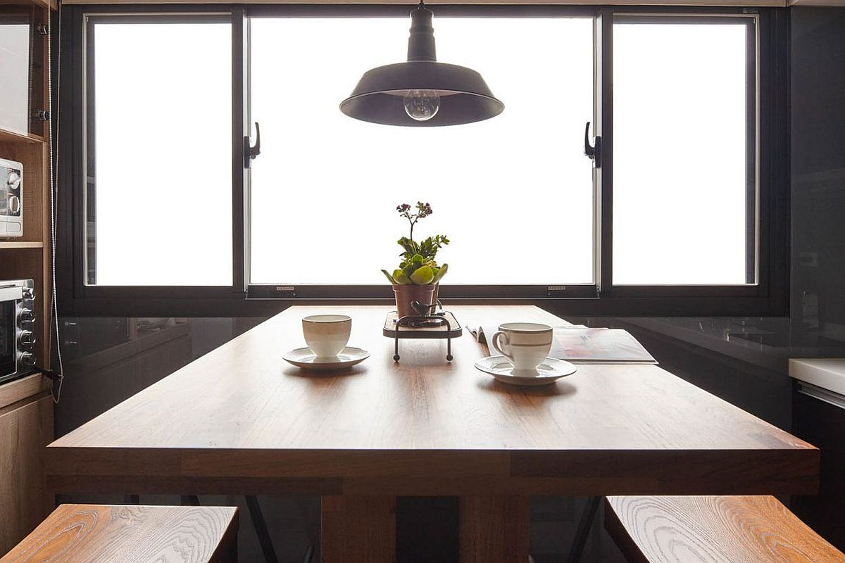 Window and pendant light combine to provide ample illumination to the kitchen
