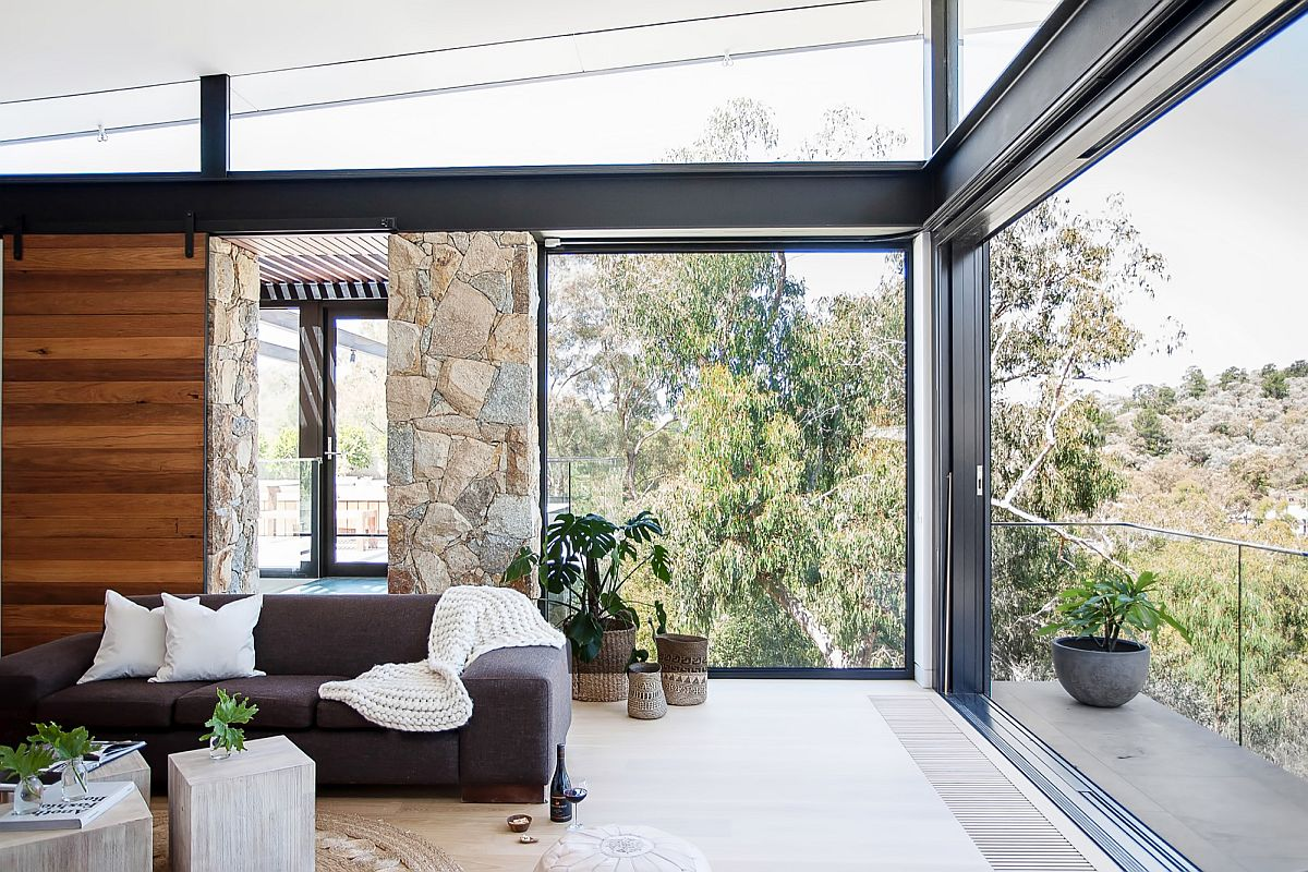 Window and sliding doors open up the corner to the view outside
