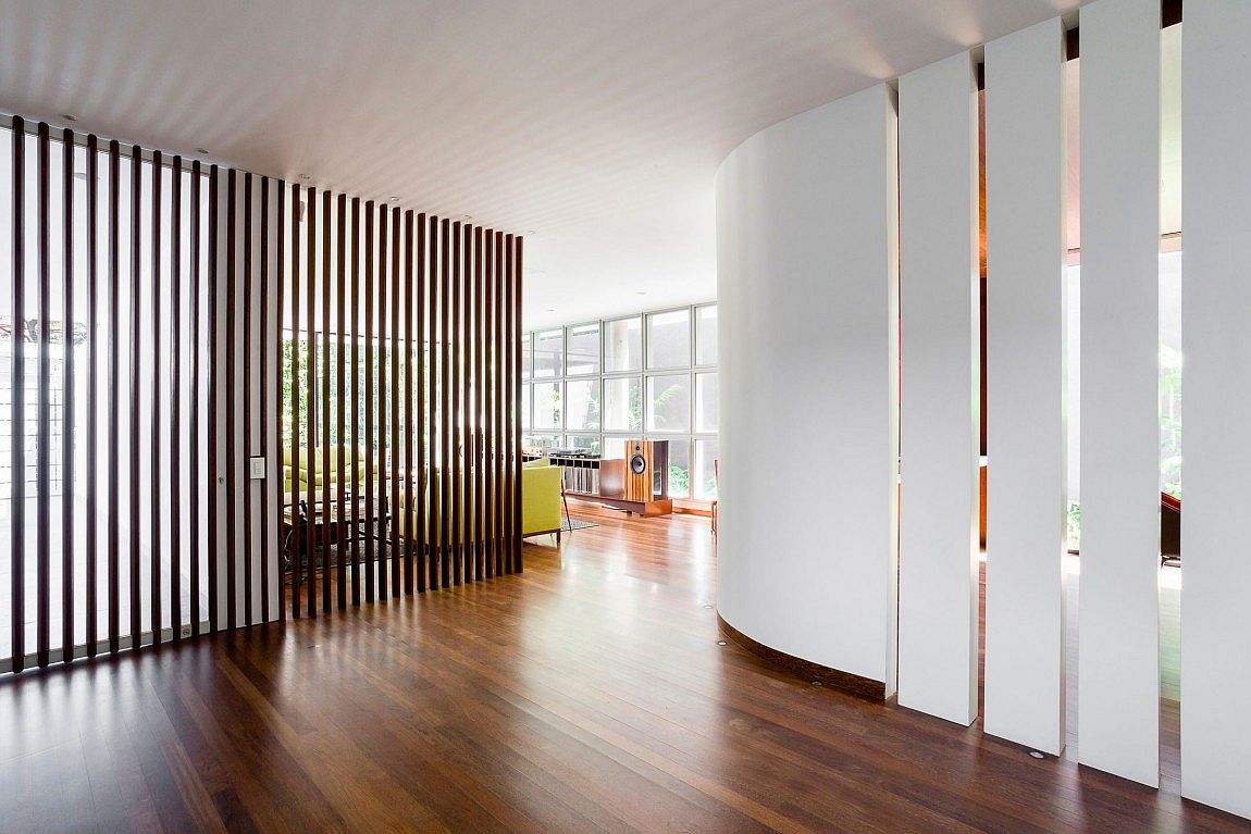 Wooden slats and partitions shape the interior of the home