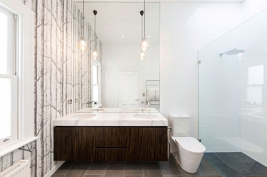 Woodsy wallpaper adds pattern to the bathroom without disturbing the color scheme