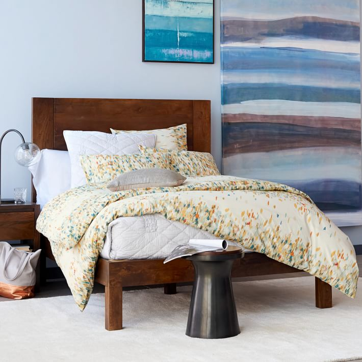 Yellow watercolor-style bedding from West Elm