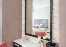 A-touch-of-coral-and-pink-invigorates-the-neutral-setting-217x155