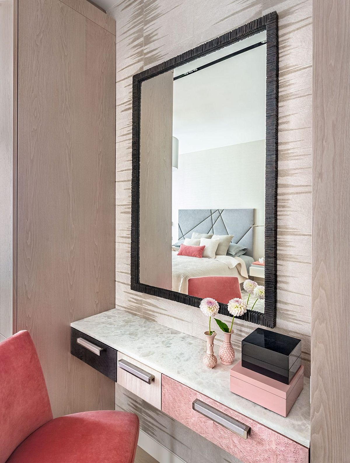 A touch of coral and pink invigorates the neutral setting