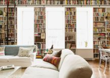 A-wall-of-books-acts-as-the-perfect-backdrop-for-the-light-filled-living-area-217x155