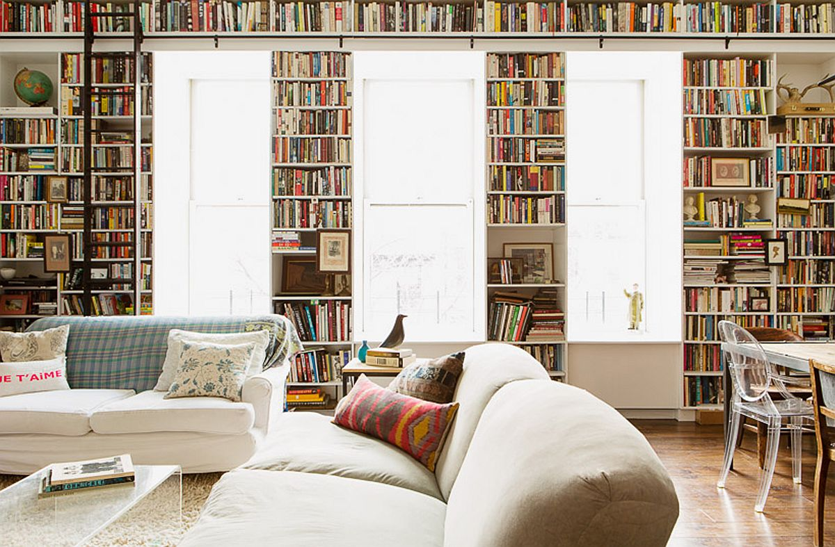 A wall of books acts as the perfect backdrop for the light-filled living area