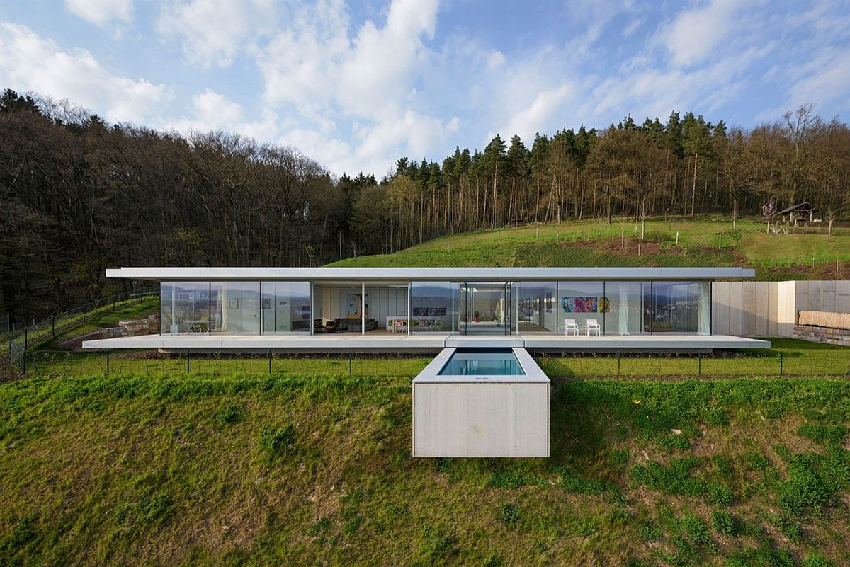 Amazing design of the pool seems to cantilever above the hill slope to create a stunning visual Pool That Seems to Float Above a Hill: Zero Energy, Minimalist Villa K