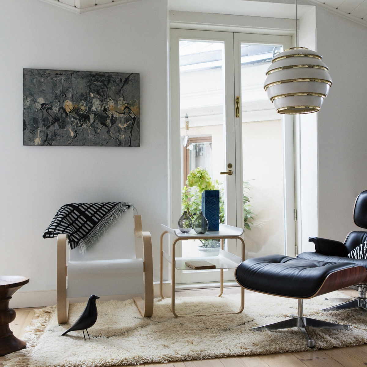 Alvar Aalto's designs shown alongside Vitra design pieces (Vitra acquired Artek in 2013). Aalto designs from left to right: Armchair 42 (1932), Table 915 (1932) and Pendant Light A331 (1953).