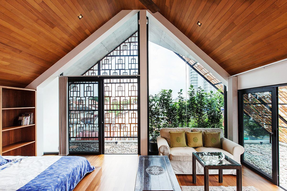 Attic bedroom of the stylish Singapore home with city views