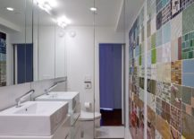 Bathroom accent wall in patchwork tiles from Ann Sacks