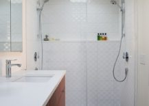 Bathroom in white with floating vanity and skylight