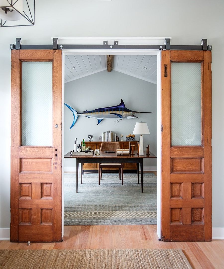 Beach style home office with sliding barn doors [Design: Heritage Homes of Jacksonville]