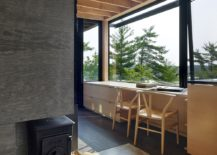 Beautiful shoreline and natural canopy become a part of the interior at the cabin