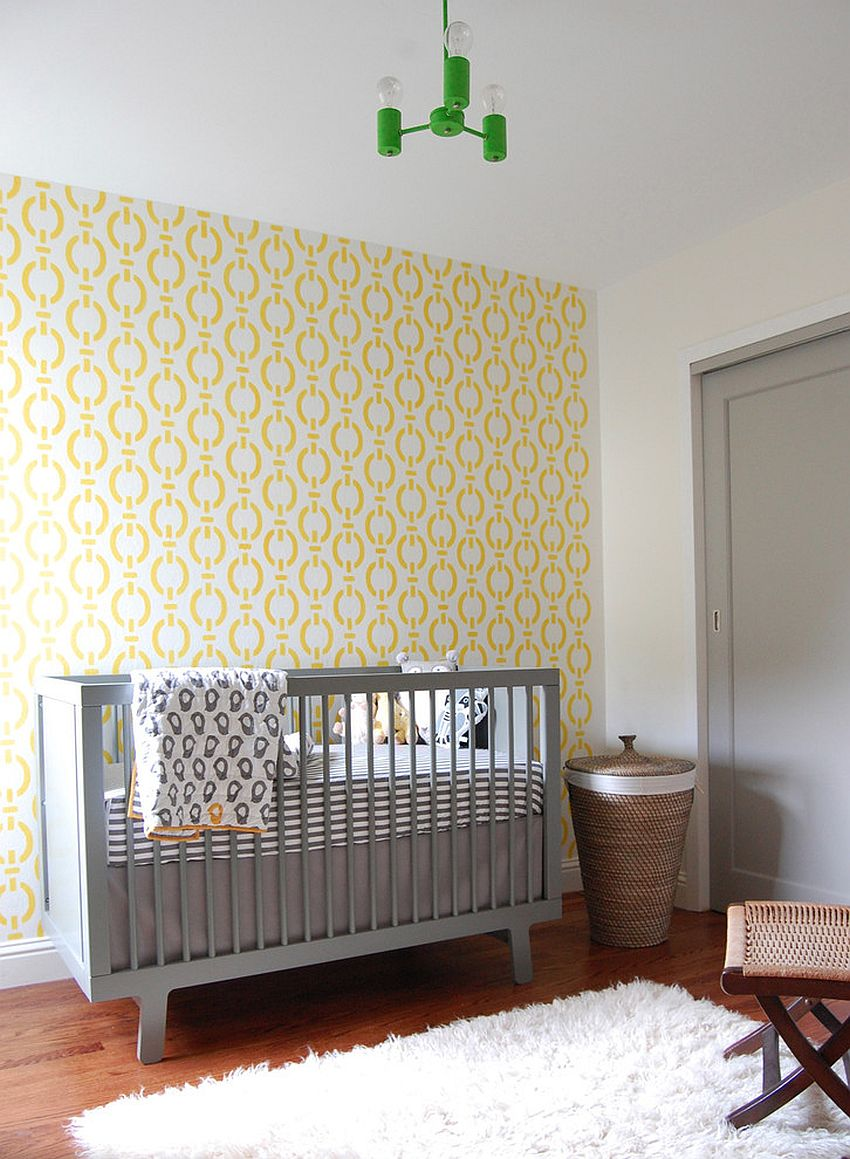 Beautiful wallpaper brings yellow while the crib adds gray to the modern nursery [Design: Niche Interiors]