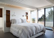 Bedroom of the remodeled Eichler home offers great views