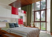 Bedroom with wooden shutters and colorful pops of red