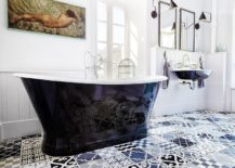Black and white bathroom with a patchwork of patterned tiles