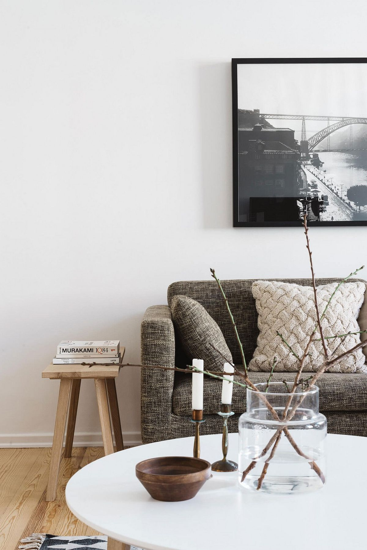 Black and white framed wall art plays into the neutral color scheme of the living room