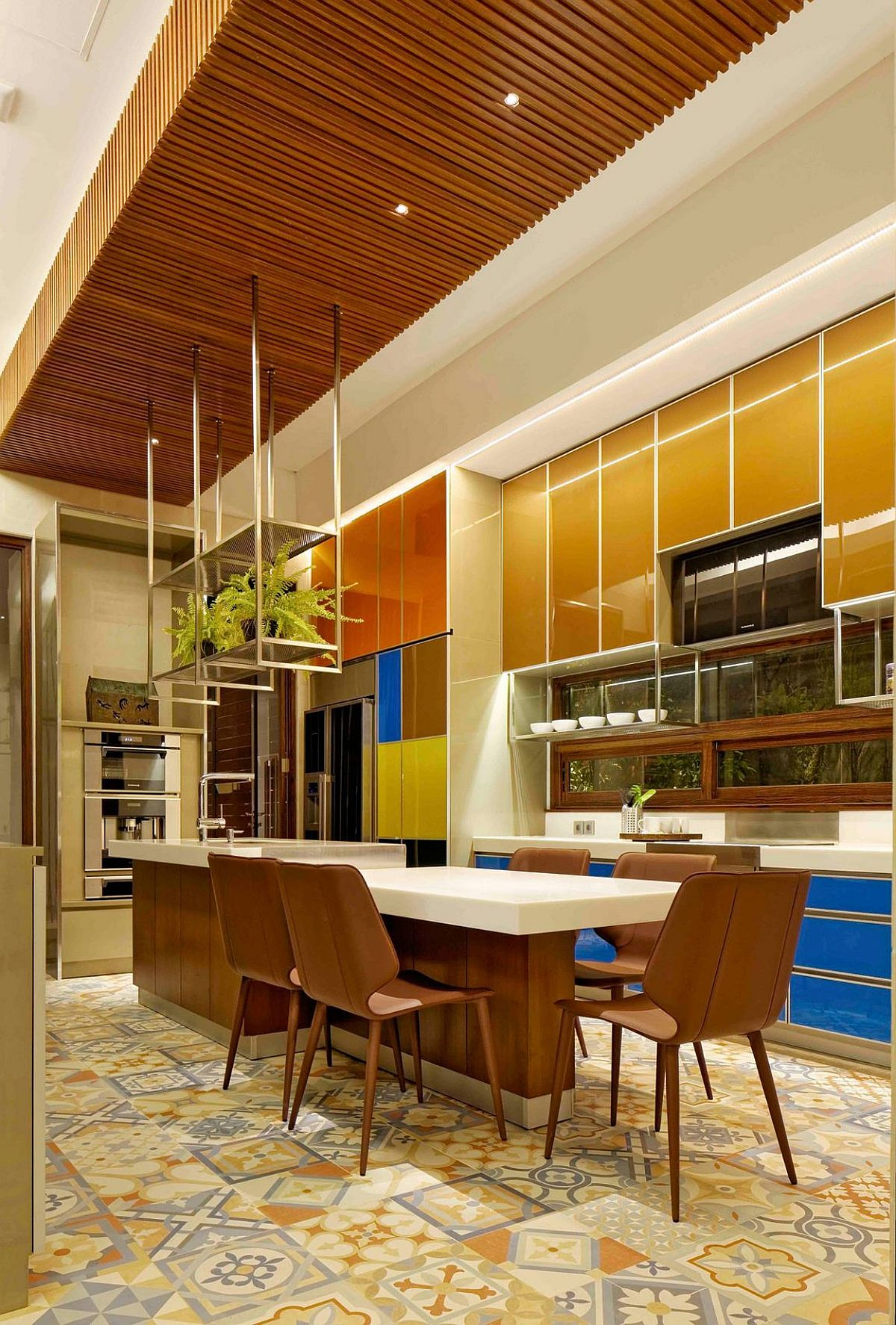 Blocks of color and an intricate ceiling create a fabulous dining room