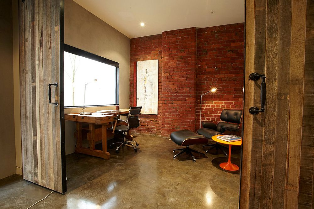 Brick wall and sliding barn door for the home office in revamped warehouse residence [Design: K+Architects]
