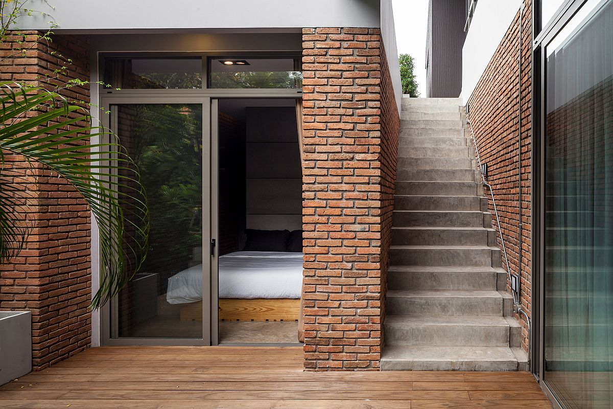 Brick walls bring industrial touch to the modern interior