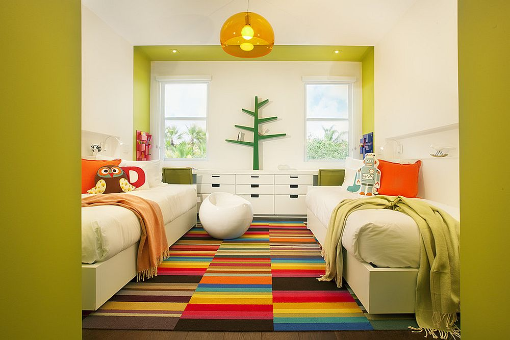 Bright and cheerful kids' room with twin beds seems super fun thanks to the multi-colored rug [Design: DKOR Interiors Inc.- Interior Designers Miami]