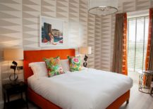 Bright orange coupled with bold geometric pattern inside the contemporary bedroom