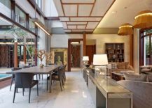 Ceiling panels add to the traditional style of the pavilion living space 217x155 Green Oasis in Jakarta Merges Javanese Tradition with Modernity
