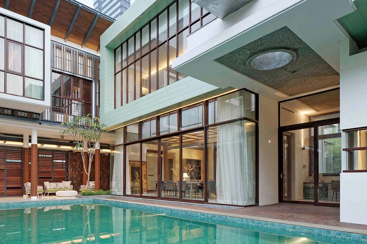 Central swimming pool is accessible from most rooms of the house