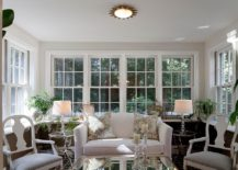 Chairs and table lamps add symmetry to the sunroom