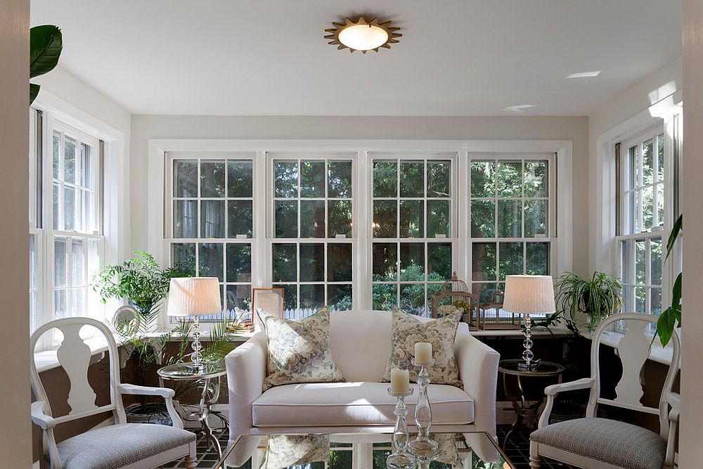 Chairs and table lamps add symmetry to the sunroom [Design: M&P Design Group]