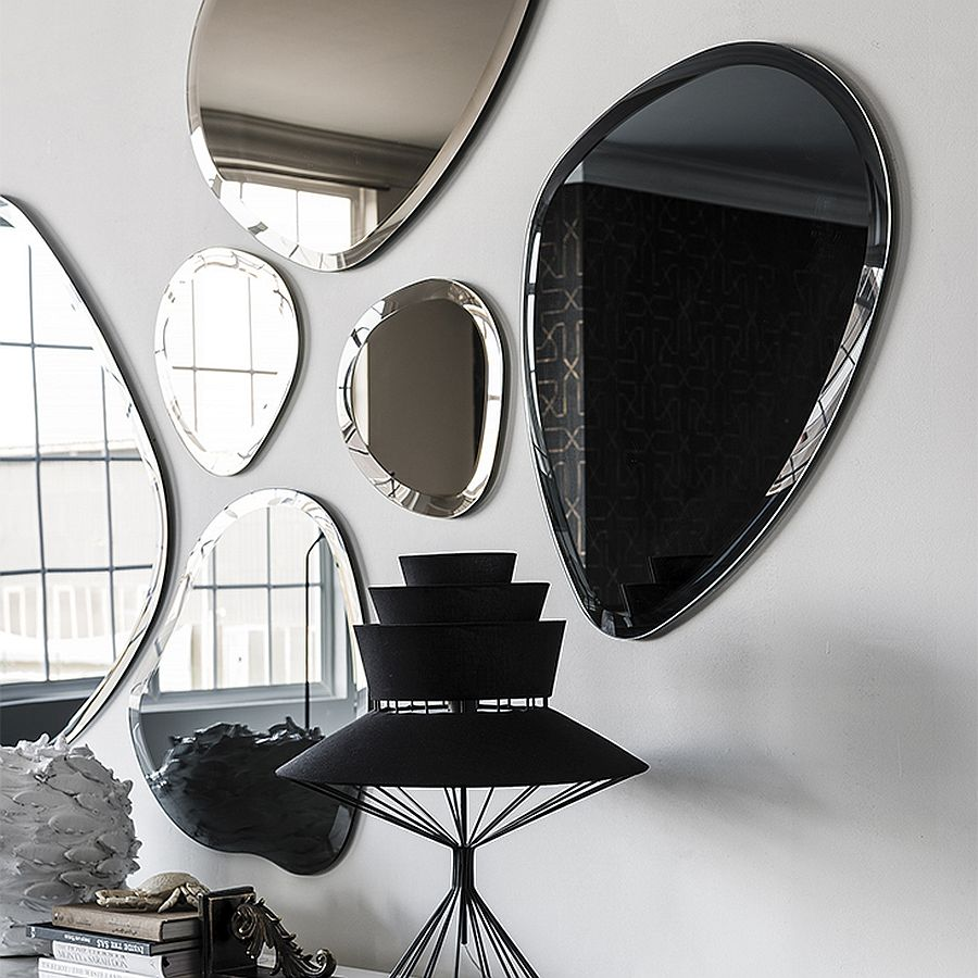 Charming mirrors create a lovely focal point in the room
