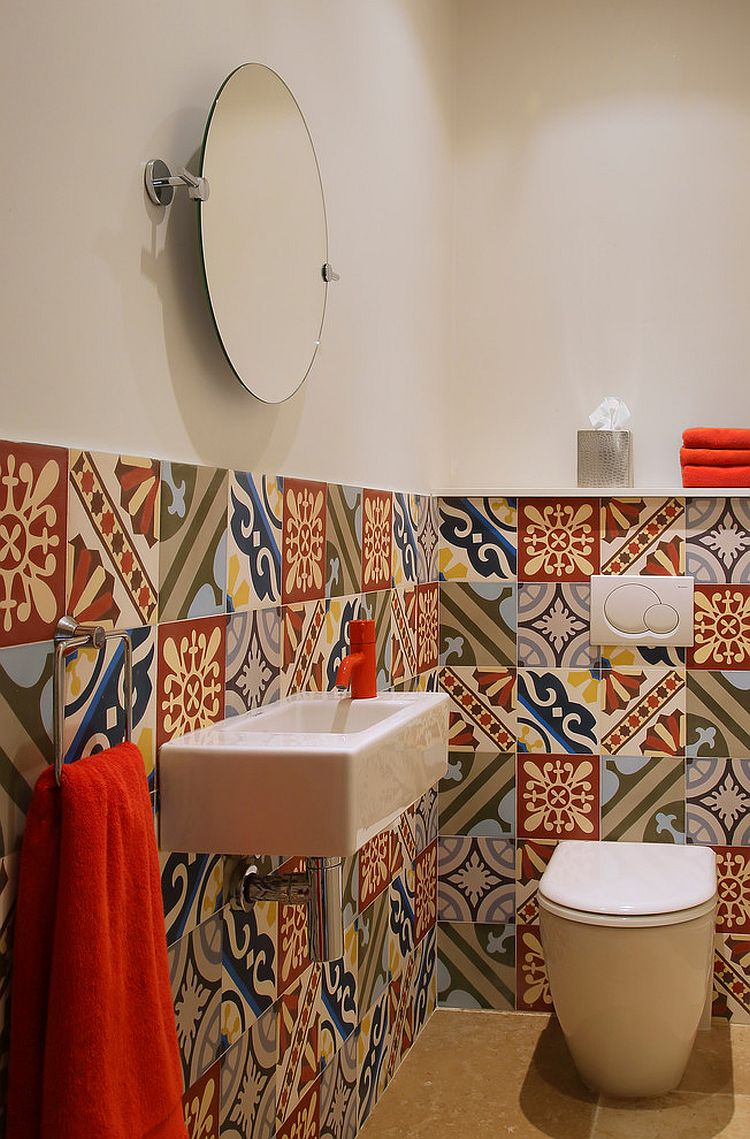 Cheerful and bright patchwork of colorful tiles is ideal for the Mediterranean powder room [Design: McQuin Partnership Interior Design]