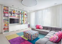 Children's media room and playroom full of color and custom cabinets