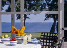 Classic-grid-tablecloth-on-a-sunny-porch-217x155