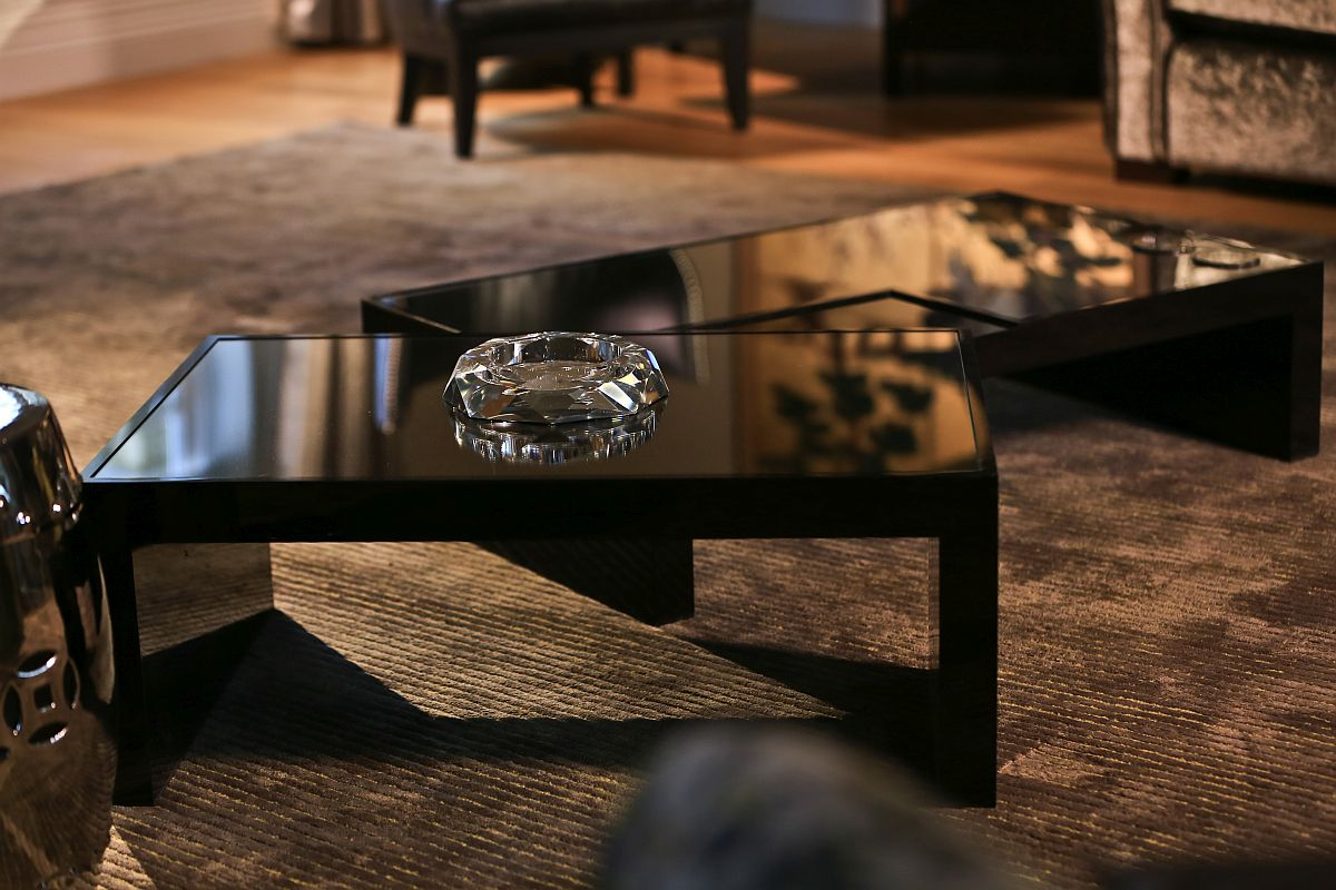 Coffee tables in black bring sophisticated glam to the living room