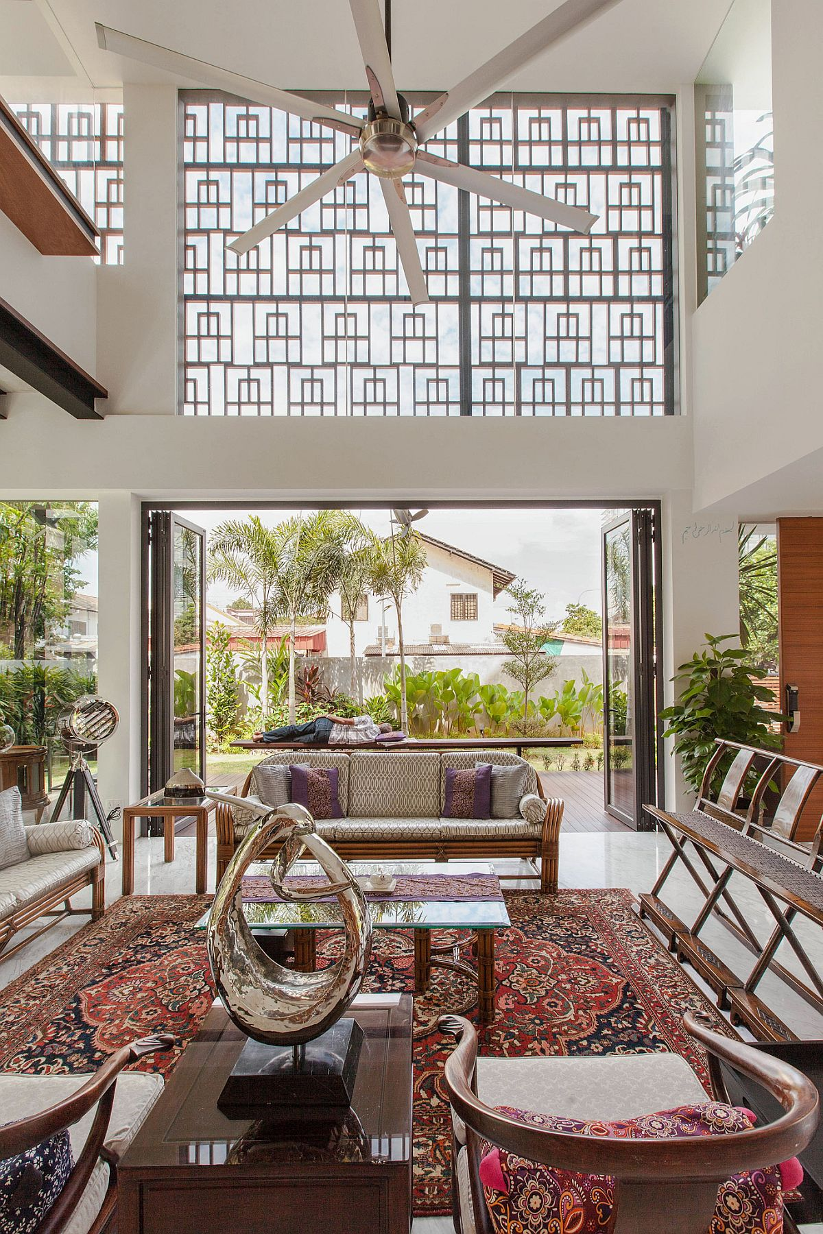 Colorful and intricate rug binds together the decor in the open living space