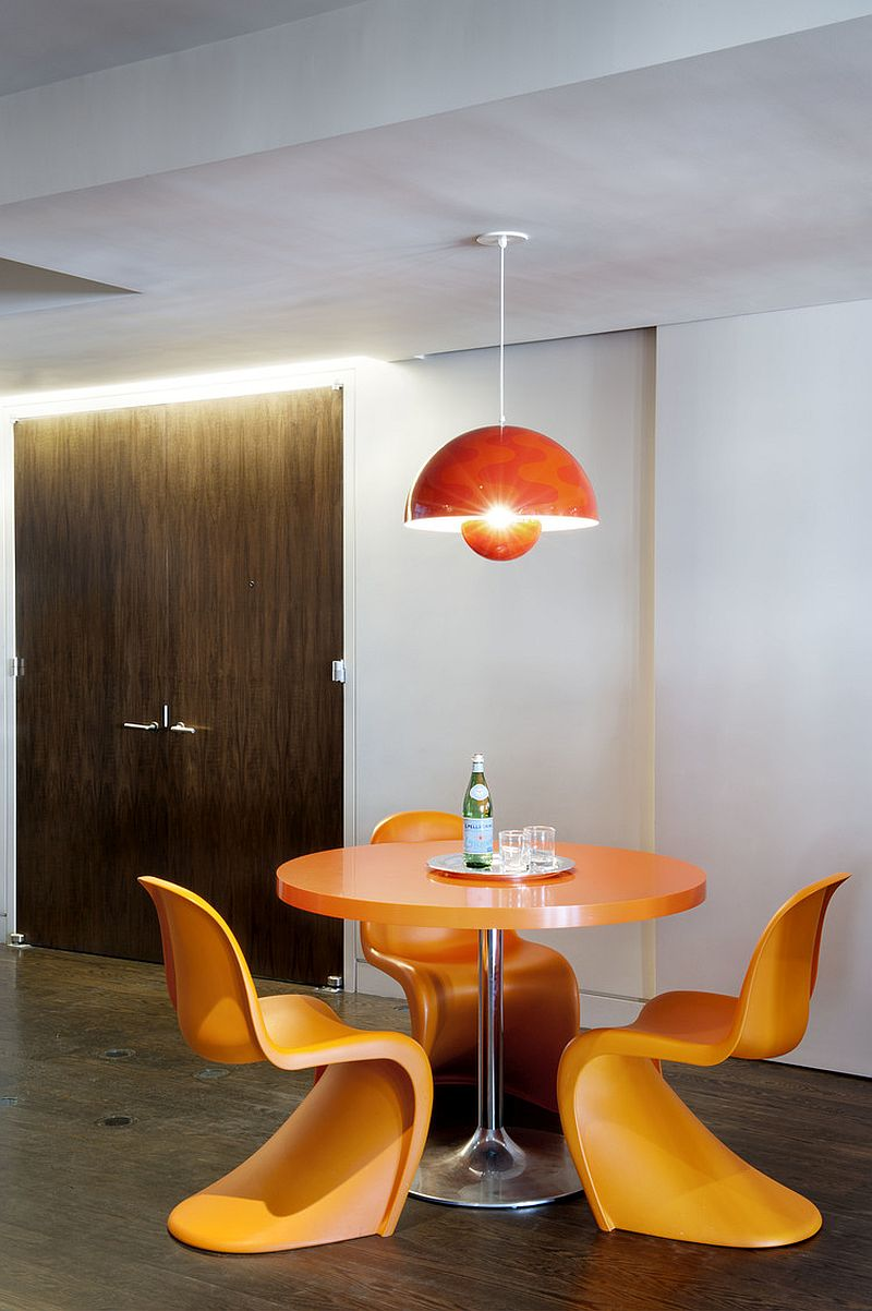 Colorful and snazzy breakfast zone with orange panton chairs