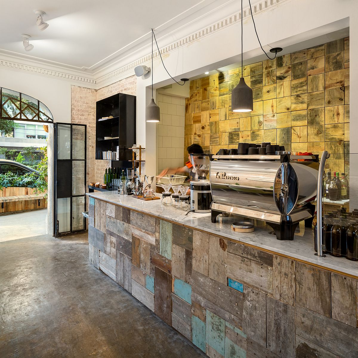 Concrete floors and reclaimed surfaces preserve the original charm of the restaurant