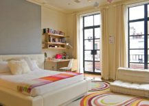Contemporary kids' bedroom inside New York home with fashionable rug