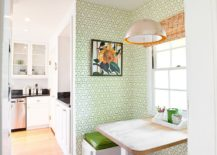 Contemporary kitchen and breakfast nook enlived with wallpaper