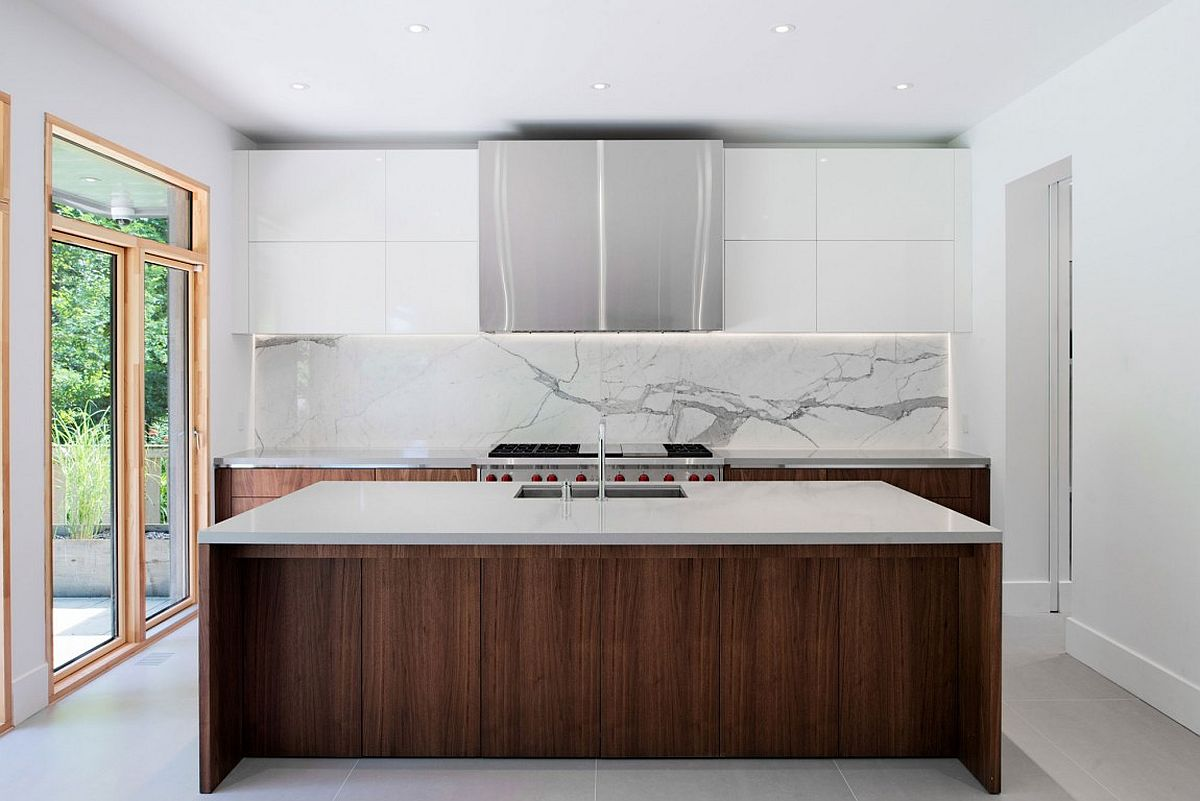 Contemporary kitchen in white with wooden lower cabinets, island and a marble backsplash