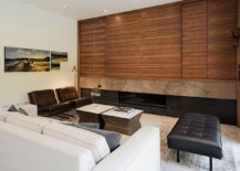 Contemporary living space with comfy decor and wooden shelves 217x155 Heathdale Residence: Cor Ten on One Side and Glass on the Other