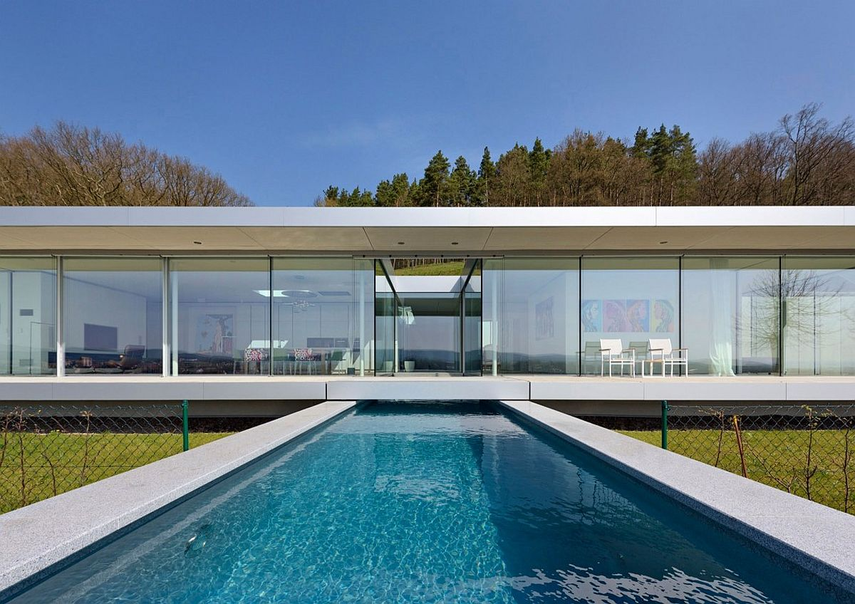 Contemporary swimming pool with solar deck at exquisite German villa