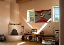 Cozy-home-office-with-a-traditional-fireplace-in-the-corner-217x155