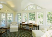 Cozy seating and a workdesk add to the appeal of the sunroom