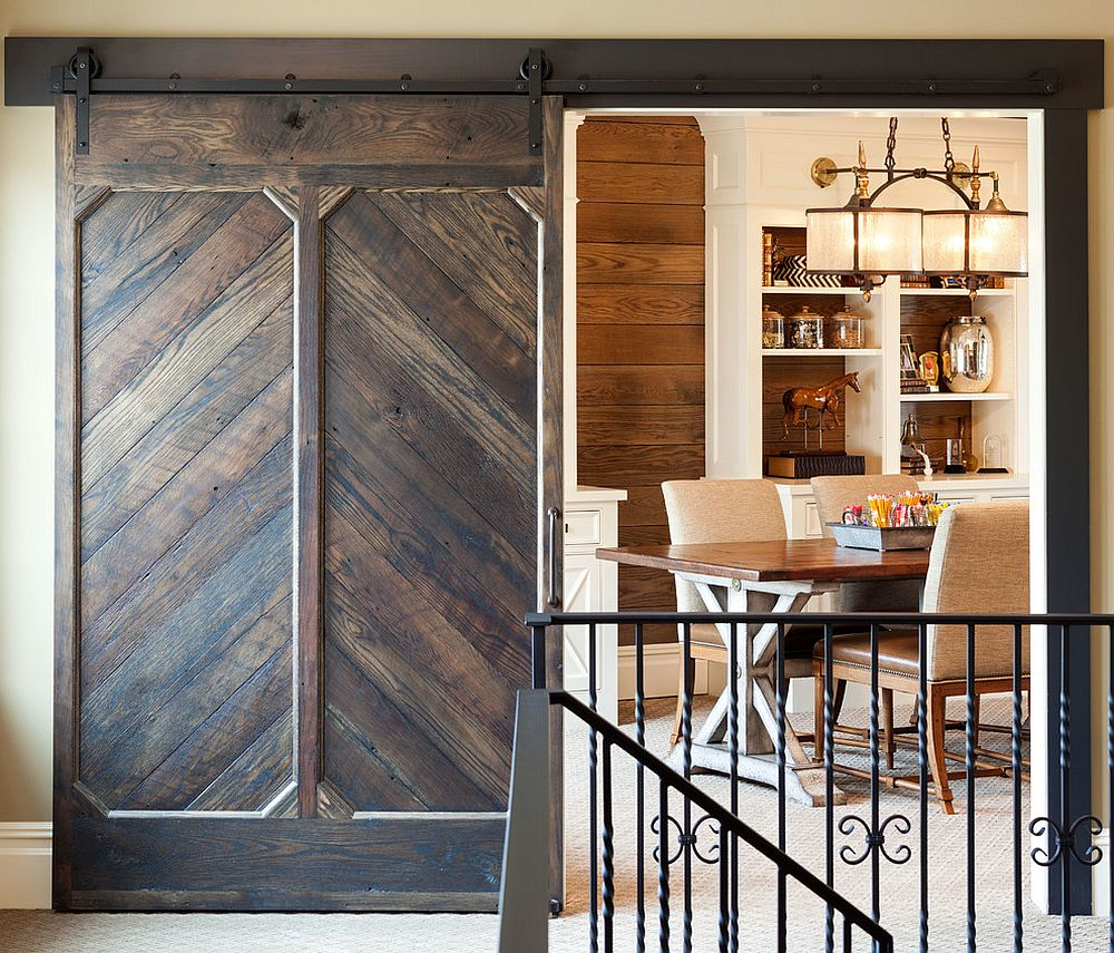 Custom designed barn door for the traditional home workspace and library [Design: John Kraemer & Sons / Murphy & Co. Design]