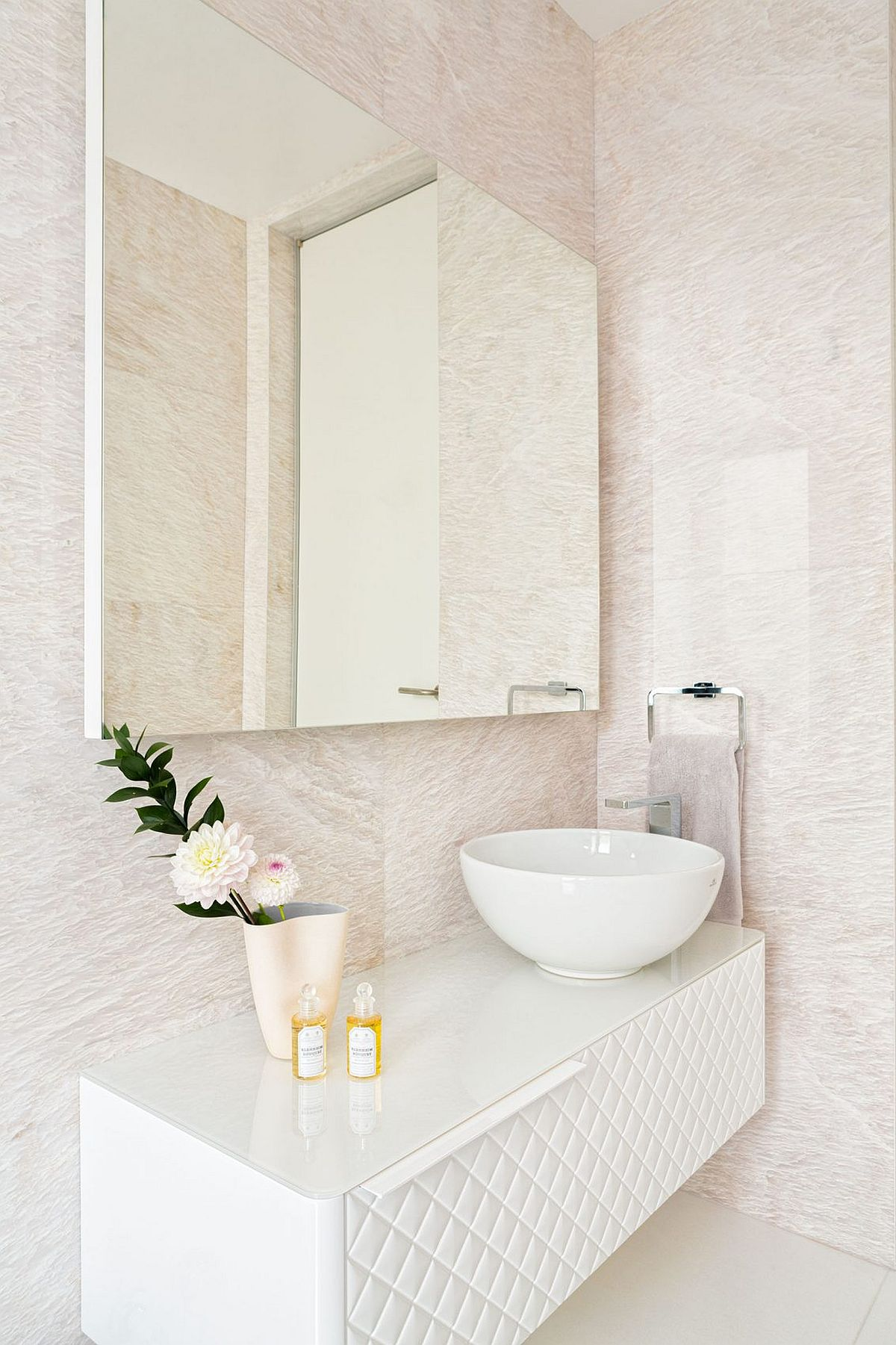 Custom floating vanity is both contemporary and glamarous