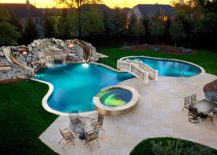 Custom swimming pool and garden with waterfalls, slides and a beautiful bridge