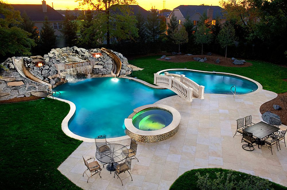 custom swimming pool and garden with waterfalls slides and a beautiful bridge design